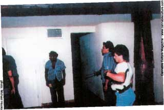 Two mexican police arrest me (far left).